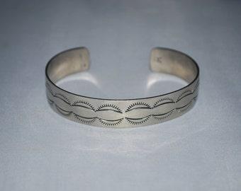 Nickel silver cuff bracelet with native american motif.