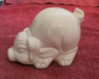 White ceramic piggy bank pig.