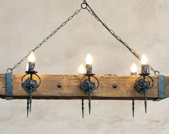 Wood beam and wrought iron chandelier for 6 lights.