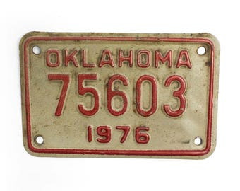 1976 Oklahoma Motorcycle License Plate - White And Red Vintage Used Bike License Plate (77-BO-LP-0129)