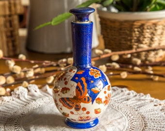 Striking richly coloured Imari perfume bottle with butterfly and flowers