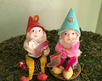 Japan little gnomes or elves on pine cones