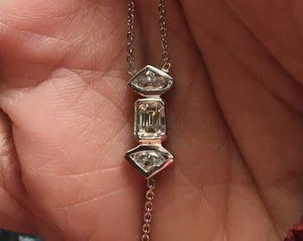 Emerald and fan cut bezel set diamond cluster lariat y necklace