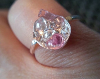 A very dainty resin set pink tourmaline and Herkimer diamond set in fine silver size 6 and 1/2