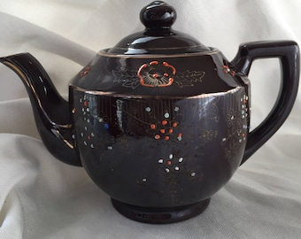 Vintage brown teapot with gold trim and orange and baby blue enamel raised dots