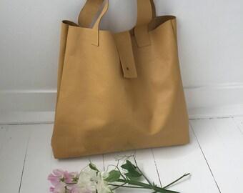 Vanilla, simple leather tote bag.