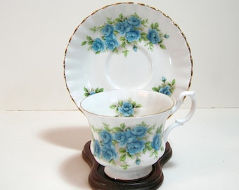 Royal Albert Bone China Cup And Saucer With Blue Roses