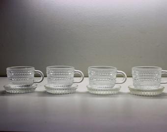 Four mocha coffee glass cups with saucer, Dewdrop, Kastehelmi, Oiva Toikka, Nuutajarvi Iittala Finland, mid-century modern vintage design