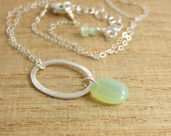 Necklace with a Pendant of A Brushed Sterling Silver Loop and a Milky Green, Glass, Oval Bead CDN-717