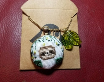 Sloth cross stitched necklace