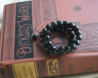 Vintage JET Glass Memory Coil Bangle with Dangles, Black Faceted Glass Beaded Cuff, Jewelry gift for her under 10 dollars