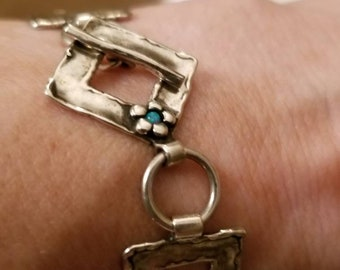 Sterling bracelet southwest theme beautiful geometric design with turquoise floral accent