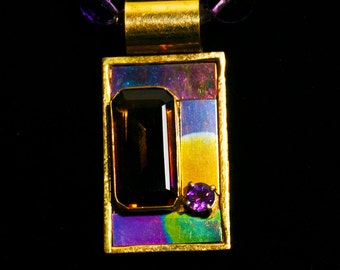 A coat of many colors in an astonishing pendant