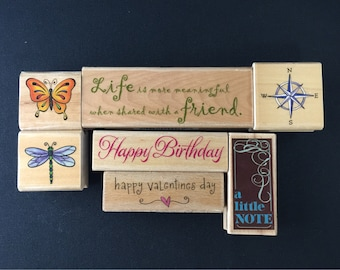 Assorted Collection of Rubber Stamps, sayings, compass, and butterflies