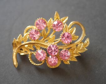 Gold tone flower brooch with pink large sparkly rhinestones