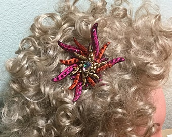 Embroidered flame flower embellished with matching Rhinestones