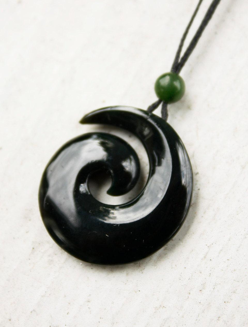 black by natural pendant harmony koru designs maori triple horn necklace shop stylized spriral