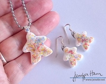 Rainbow sprinkle MEEPLE! super cute meeple glass earrings and necklace made by Jenefer Ham