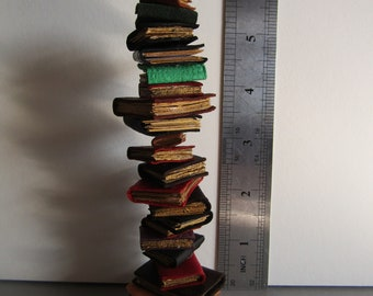12th scale tower of 'wobbly' books by Kastlekelm miniatures