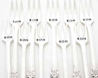 Nom nom nom appetizer forks. Vintage hand stamped silverware to spear pickles, cheese or charcuterie. Party table decor.