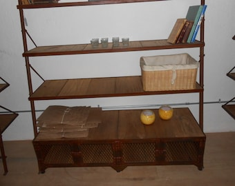 Vintage antique reproduction of an old bookshelving with storage credenza