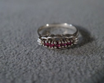 vitnage sterling silver band style ring with round faceted garnets and a decorative setting, size 6               M