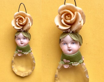 spring ornament, flower child, mixed media assemblage altered art doll, doll head ornament by Elizabeth Rosen