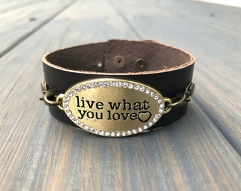 Brown leather bracelet with live what you love tag