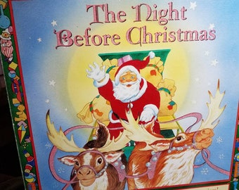 The Night Before Christmas Board Book with flaps and surprises Maggie Downer
