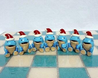 Blue quaggan figurine with santa hat
