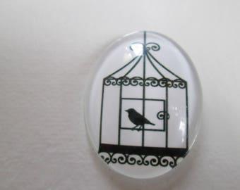 A glass cabochon printed 30 x 40 mm bird motif