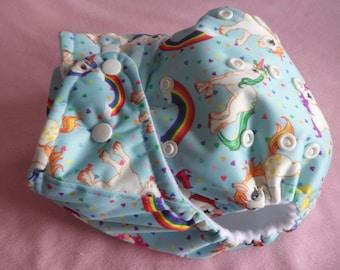 SassyCloth one size pocket diaper with rainbow unicorns PUL print. Ready to ship.