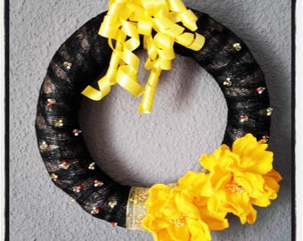 Wreath door, yellow flowers, pearls and ribbons to hang