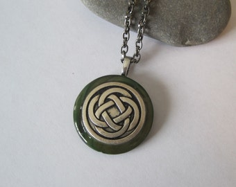 Celtic Knot on Mother of Pear shell . Pendant Necklace.