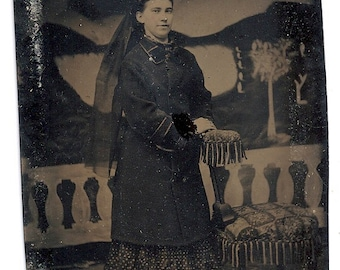 tintype girl with veil painted backdrop photographer's chair spooky