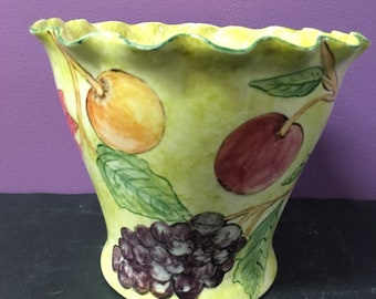 Floated edge vase with fruits and flowers