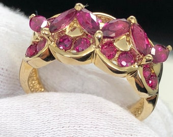 Natural pink Sapphires in 14k gold setting. Marquis and round shape, great color, rare piece.
