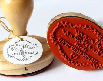 Stamped Merry Christmas and a happy new year oval