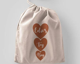 Personalised children's hearts toy tidy drawstring bag