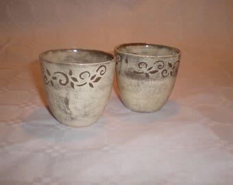 Set of two off-white ceramic mugs
