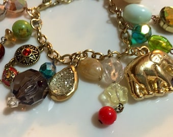 Elephants never forget gold charm bracelet, vintage charms, beads and jewelry. Adorable charm bracelet