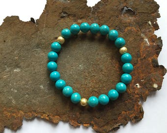 Turquoise bracelet with gold-plated sterling silver elements