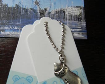 pair of tags and metal charm silver bottle