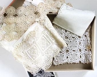 Collection of vintage lace doilies and napkins.