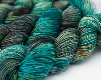 "Hand Dyed Sock Yarn, Variegated Turquoise, Black, and Green, Superwash Merino Wool, Cashmere, and Nylon, Color ""Underwater Sunshine"""