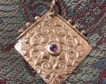 Beautiful pendant in fine silver made from pmc. Please note this is made to order and the stones may vary