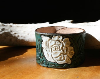 Leather cuff bracelet, tooled with white rose design on turquoise leather