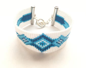 Lovely blue and white bracelet woven with miyuki beads