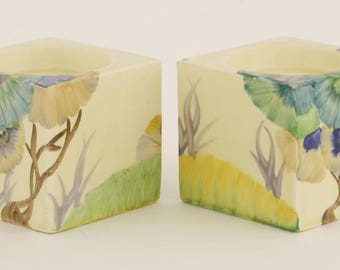 A pair of Clarice Cliff Bizarre 'Rhodanthe' candle holders, printed and moulded marks,  6cm high