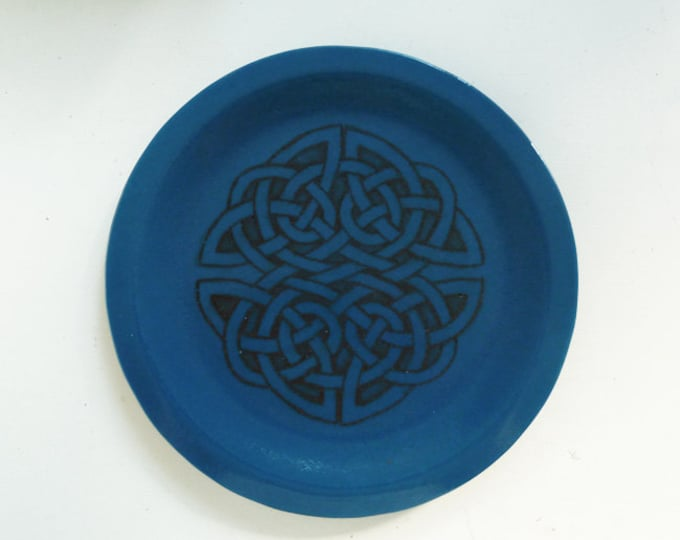 Steel blue fused glass plate with hand-drawn celtic knotwork design